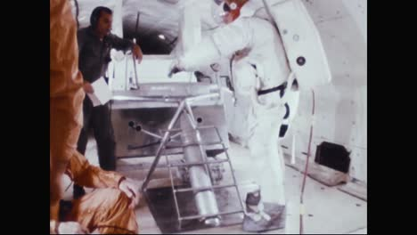 Astronauts-Neil-Armstrong-Buzz-Aldrin-And-Fred-Haise-Practice-Walking-Up-A-Ladder-While-In-Training-In-A-Zero-Gravity-Simulation-1969