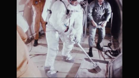 Astronaut-Neil-Armstrong-Practices-Collecting-Dirt-Samples-While-In-Training-1969