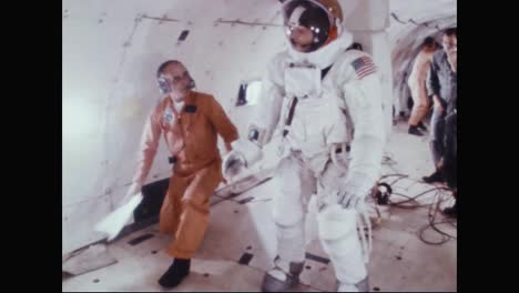 Astronaut-Neil-Armstrong-Practices-Walking-And-Falling-In-His-Spacesuit-While-Training-In-A-Zero-Gravity-Simulation-1969
