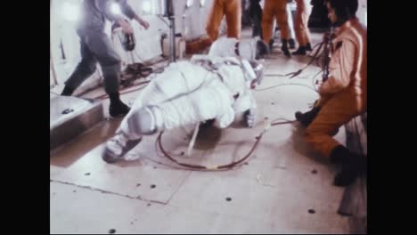 Astronauts-Neil-Armstrong-Buzz-Aldrin-And-Fred-Haise-Practice-Getting-Up-After-Falling-In-their-Space-Suits-1969