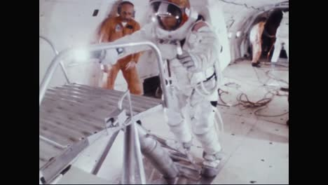 Astronauts-Neil-Armstrong-And-Buzz-Aldrin-Practice-Climbing-A-Ladder-In-their-Space-Suits-1969