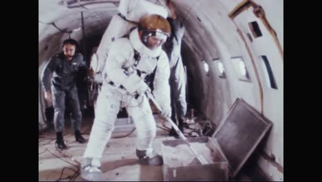 Astronaut-Neil-Armstrong-Uses-A-Scoop-To-Collect-Dirt-Samples-While-In-A-Spacesuit-And-Nearly-Falls-Over-During-His-Training-1969