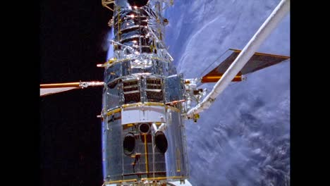 the-Hubble-Space-Telescope-Is-Seen-Orbiting-the-Earth-Astronauts-Are-Seen-Working-On-It