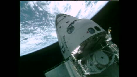 Views-Of-the-Earth-And-the-Moon-Are-Shown-As-Astronauts-Conduct-An-Eva-On-the-Orbiting-Hubble-Space-Telescope