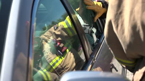 Firefighters-Demonstrate-How-To-Break-Into-A-Car-In-Case-Of-A-Fire-Emergency