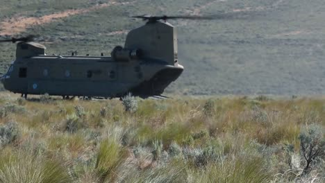 American-Troops-Disembark-From-A-Transport-Helicopter-In-A-Dry-Field