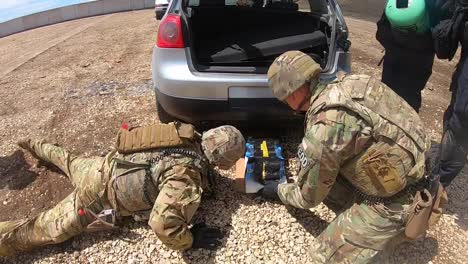 Us-Army-Eod-Specialists-And-Kosovo-Bomb-Squad-Members-Use-Special-Technology-On-Cars-that-Have-Been-Blown-Up