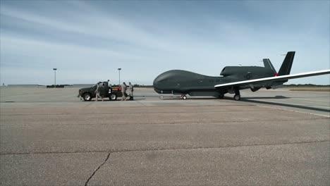 A-Usaf-Northrop-Grumman-Rq4-Global-Hawk-Is-Towed-Along-A-Runway-At-An-Air-Base
