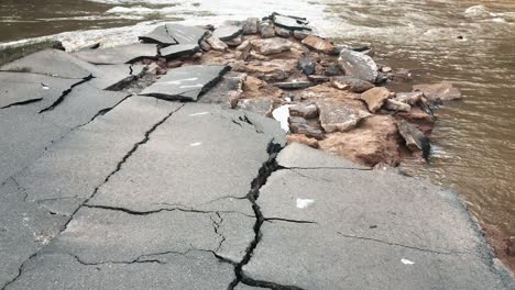 Flood-Waters-Overtake-A-Cracked-Road