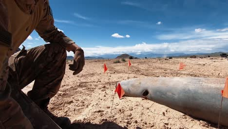 Us-Army-Eod-Techs-Dig-A-Hole-For-And-Prepare-A-Munitions-Piece