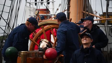 Members-Of-the-Us-Coast-Guard-Spin-the-Steering-Wheel-Of-the-Uscgc-Eagle-(Wix327)-While-Taking-Part-In-the-Tall-Ships-Festival