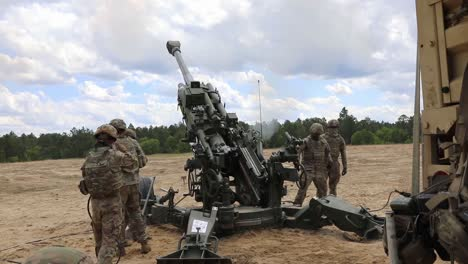 Soldiers-Assigned-To-A-Field-Artillery-Regiment-Train-By-Loading-And-Firing-A-M777-Howitzer-At-Fort-Bragg-North-Carolina-2