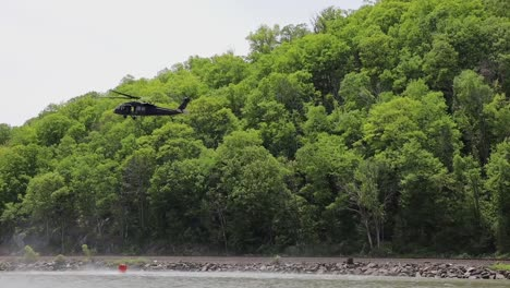 New-York-And-Connecticut-National-Guard-And-Black-Hawk-Helicopter-Crews-Train-To-Fight-Wildfires-With-Water-Buckets