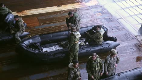 Us-Marines-Prepare-For-Launch-And-Recovery-Drills-With-Rubber-Raiding-Craft-From-A-Ship-In-the-Philippine-Sea