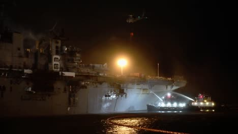 A-Helicopter-Fights-A-Fire-Aboard-Amphibious-Assault-Ship-Uss-Bonhomme-Richard-Dockside-At-Naval-Base-San-Diego-Ca-3