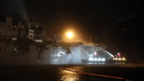 A-Helicopter-Fights-A-Fire-Aboard-Amphibious-Assault-Ship-Uss-Bonhomme-Richard-Dockside-At-Naval-Base-San-Diego-Ca-4