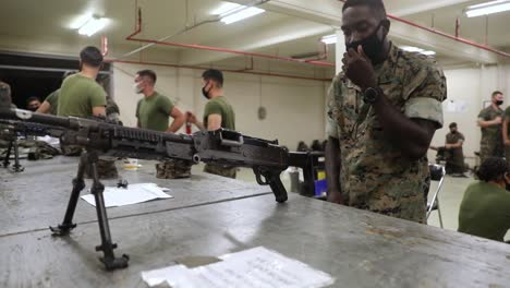 An-African-American-Marines-With-Combat-Logistics-Battalion-4-Takes-A-Machine-Gun-Class-At-Camp-Kinser-Okinawajapan