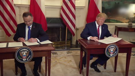 Us-President-Donald-Trump-Andrzej-Duda-President-Of-Poland-Execute-A-Treaty-At-the-White-House-Signing-Ceremony