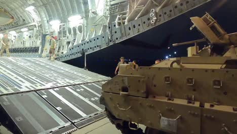 Us-Army-Task-Force-Spartan-Shield-Soldiers-Load-M2-Bradley-Fighting-Vehicles-Onto-A-Cargo-Plane-For-Syria