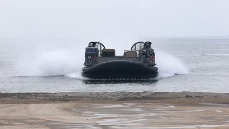 Us-Marine-Air-Cushioned-Landing-Craft-Tranports-Weapons-From-Ship-To-Shore-During-A-Field-Exercise-California