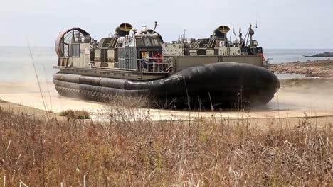 Us-Marine-Air-Cushioned-Landing-Craft-Inflates-And-Enters-the-Ocean-During-A-Field-Exercise-California