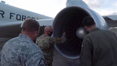 Joint-Surveillance-And-Target-Attack-Radar-System-Aircraft-Maintenance-Crew-And-A-Jet-At-Kadena-Air-Base-Japan