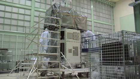 Scientists-Work-In-A-Heavily-Controlled-Lab-To-Prepare-A-Satellite-At-Nasa