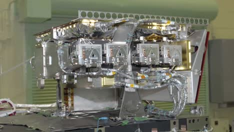 Scientists-Work-In-A-Heavily-Controlled-Lab-To-Prepare-A-Satellite-At-Nasa-1