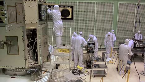 Scientists-Work-In-A-Heavily-Controlled-Lab-To-Prepare-A-Satellite-At-Nasa-2