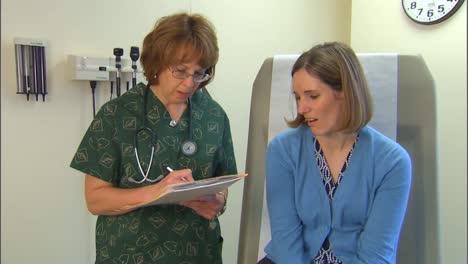 A-Doctor-Treats-A-Patient-For-Flu-Like-Symptoms