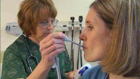 A-Doctor-Treats-A-Patient-For-Flu-Like-Symptoms-1