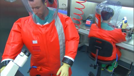 Cdc-Center-For-Disease-Control-Scientists-Wear-Biohazard-Suits-To-Study-Deadly-Viruses-In-A-Lab-8