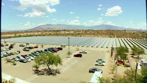 Tilt-Down-To-A-Large-And-Impressive-Solar-Panel-Array-Powering-A-Business