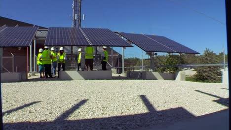 A-Maintenance-Team-Works-On-Solar-Panel-Arrays