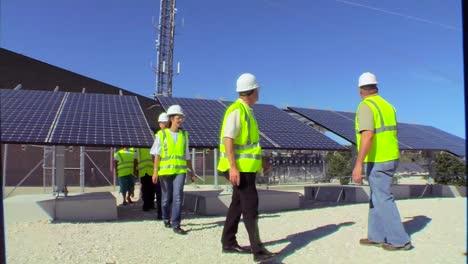A-Maintenance-Team-Works-On-Solar-Panel-Arrays-1