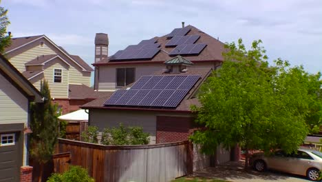 Aerial-Of-Solar-Panels-Adorning-The-Tops-Of-Houses-In-A-Residential-Neighborhood