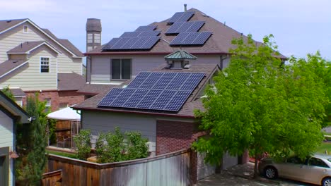 Zoom-Out-From-Solar-Panels-Adorning-The-Tops-Of-A-House-In-A-Residential-Neighborhood