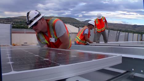 A-Maintenance-And-Installation-Team-Works-On-Solar-Panel-Arrays
