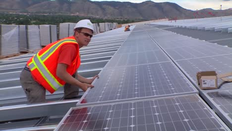 A-Maintenance-And-Installation-Team-Works-On-Solar-Panel-Arrays-1