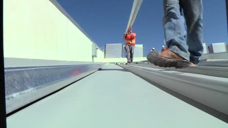 A-Maintenance-And-Installation-Team-Works-On-Solar-Panel-Arrays-3