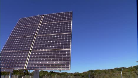 A-Solar-Panel-Array-Is-Used-To-Power-A-Television-Transmitter-And-Tower