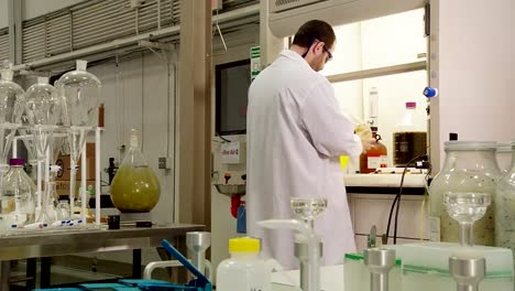 A-Scientist-In-The-Lab-Inspects-Crude-Oil-Samples-Derived-From-Algae