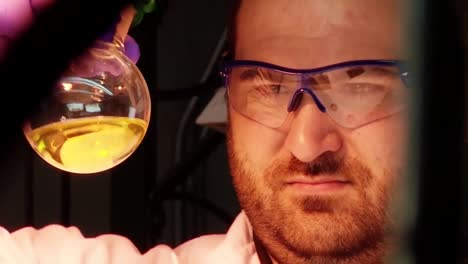 A-Scientist-In-The-Lab-Inspects-Crude-Oil-Samples-Derived-From-Algae-1