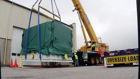 A-Large-Fuel-Cell-Module-Is-Loaded-Onto-A-Truck-For-Delivery