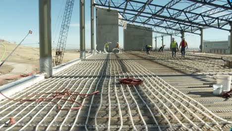 Heating-Is-Distributed-Under-A-Building-Through-Radiant-Piping-During-Construction