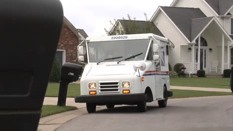 Us-Postal-Vehicles-Deliver-Mail-In-Suburban-Neighborhoods-3