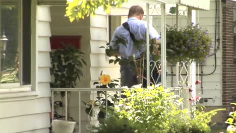 Us-Letter-Carriers-Deliver-Mail-By-Hand-In-Suburban-Neighborhoods