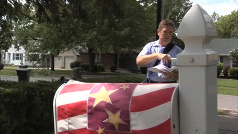 Us-Letter-Carriers-Deliver-Mail-By-Hand-In-Suburban-Neighborhoods-1