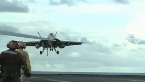 Jets-Land-And-Take-Off-From-The-Deck-Of-An-Aircraft-Carrier
