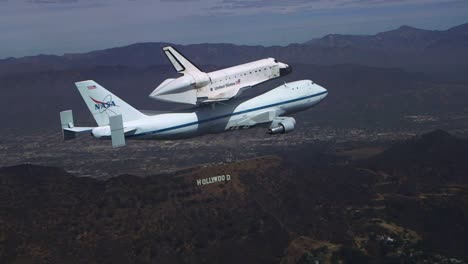 The-Final-Voyage-Of-Space-Shuttle-Enterprise-Flying-Over-Downtown-Los-Angeles-And-The-Hollywood-Sign